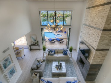 Stone & tile fireplace, disapearing glass doors